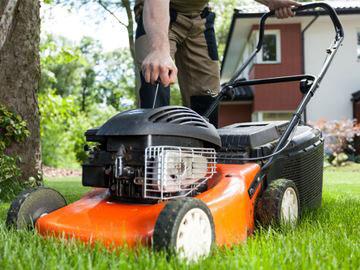 Man Starting Lawnmower, Orange Lawnmower