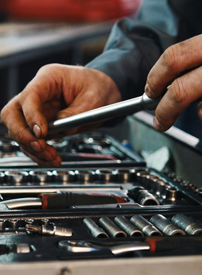Man Changing Socket Wrench, Tools